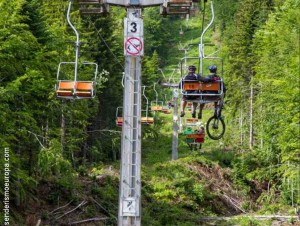 Chairlift with bicycle riders